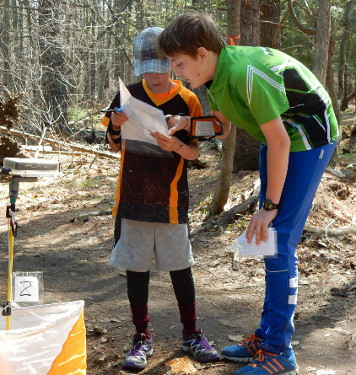 Evan Gibbard helping a youngster at the junior program